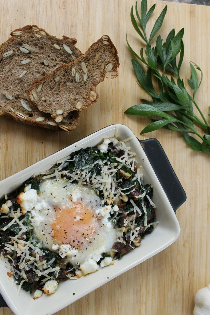 Spinach, goats cheese, pine nuts and sage baked eggs